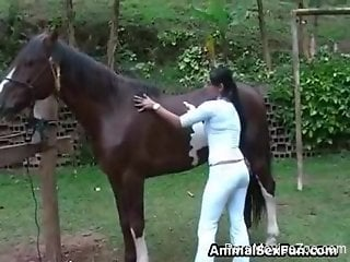 Hot woman getting undressed and jerking stallion's rod