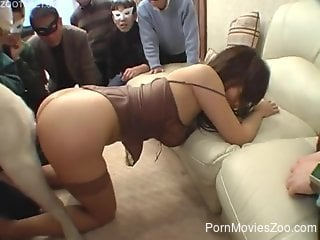 Japanese hottie gets fucked by a dog in front of a crowd