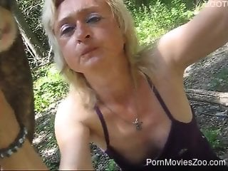Mature blonde cannot wait to suck on this dog's dick